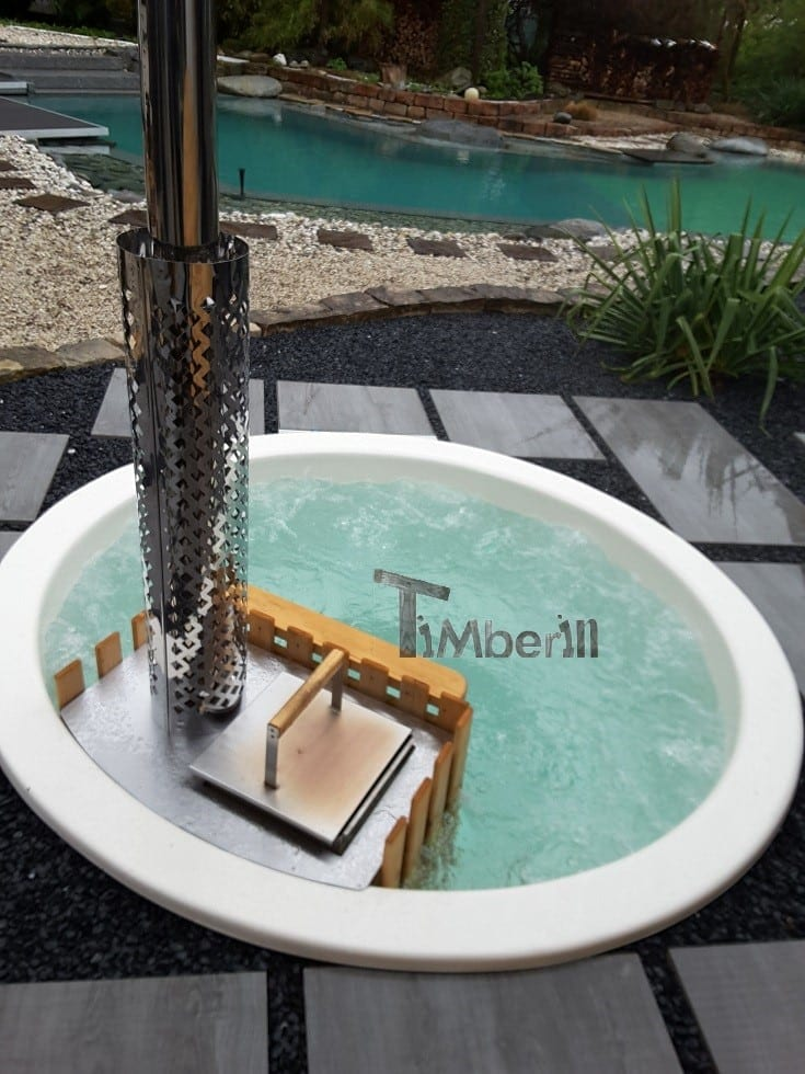 Inground hot tub with the snorkel wood fired heater