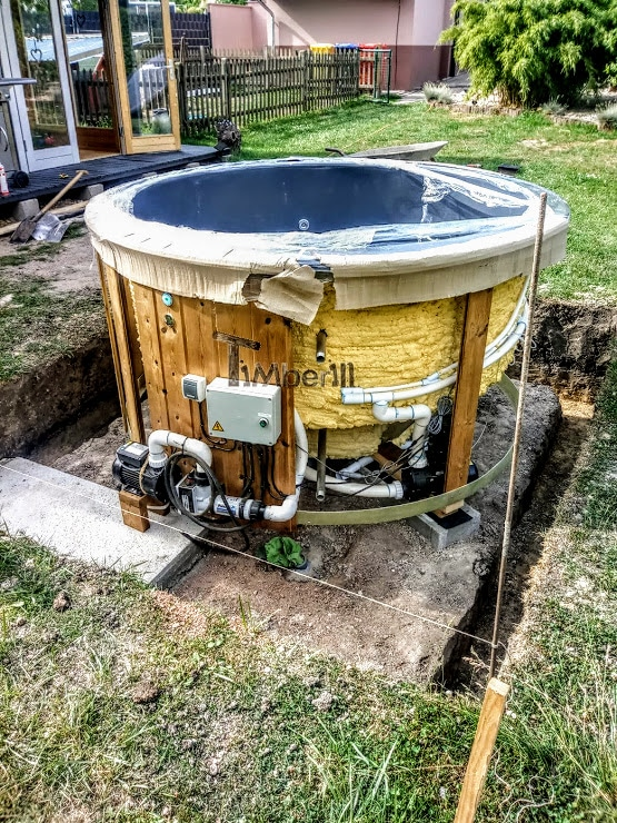 Sunken built in fiberglass hot tub with the electric heater