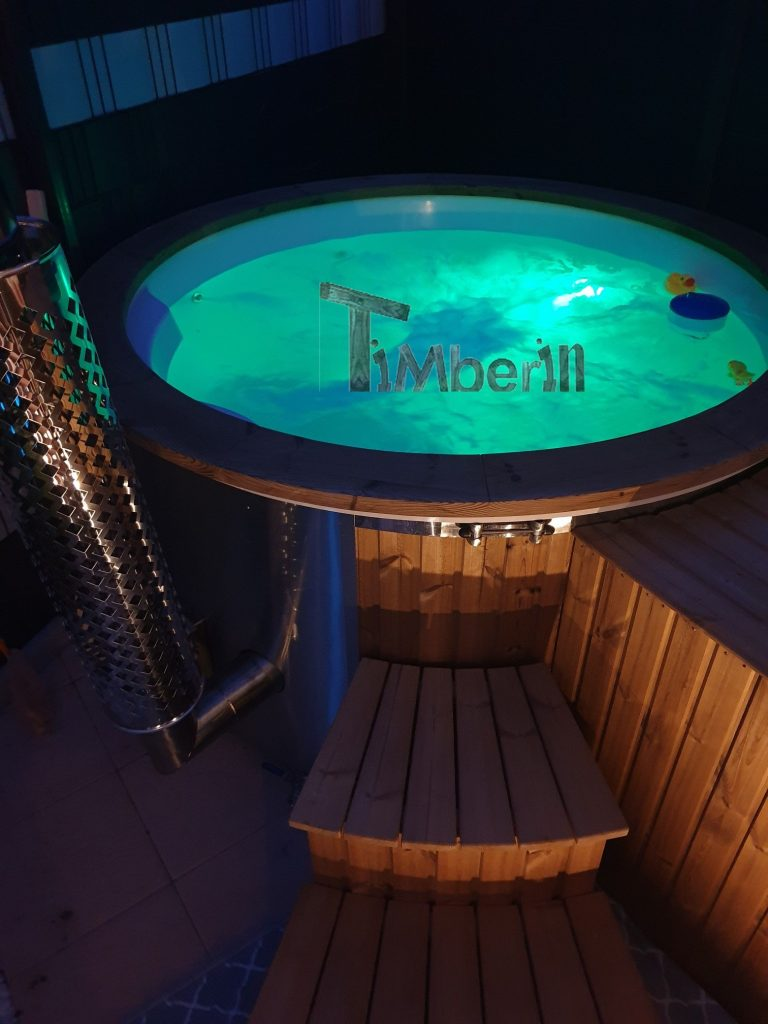 Wood fired hot tub with water and LED