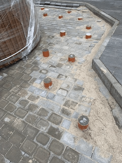 Concrete posts with paving for the wooden terrace base